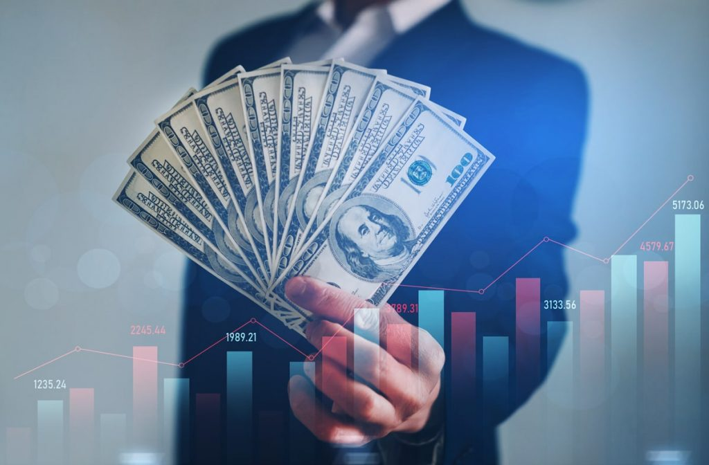 businessman-holding-bunch-dollars-financial-investment-growing-growth-development