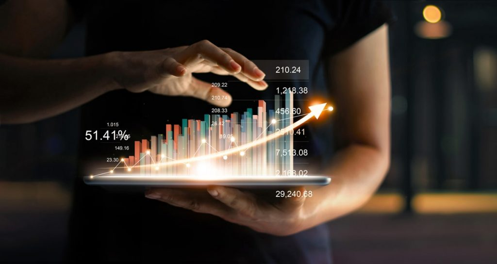 businessman-holding-tablet-showing-growing-virtual-hologram-statistics-graph-chart-with-arrow-up-min